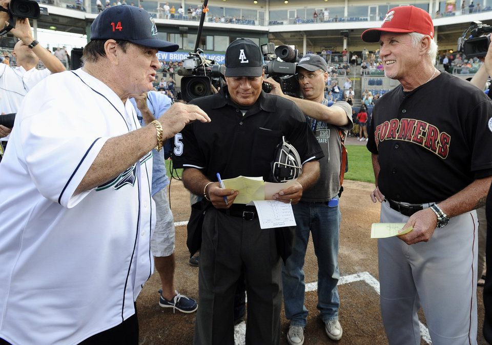 Photo - Pete Rose, left, and Lancaster Barnstormers manager Butch Hobson, right, talk at home plate before a game at The Ballpark at Harbor Yard, Monday, June 16, 2014, in Bridgeport, Conn. Rose, banned from Major League Baseball, returned to the dugout for one day to manage the independent minor-league Bridgeport Bluefish. (AP Photo/Jessica Hill)