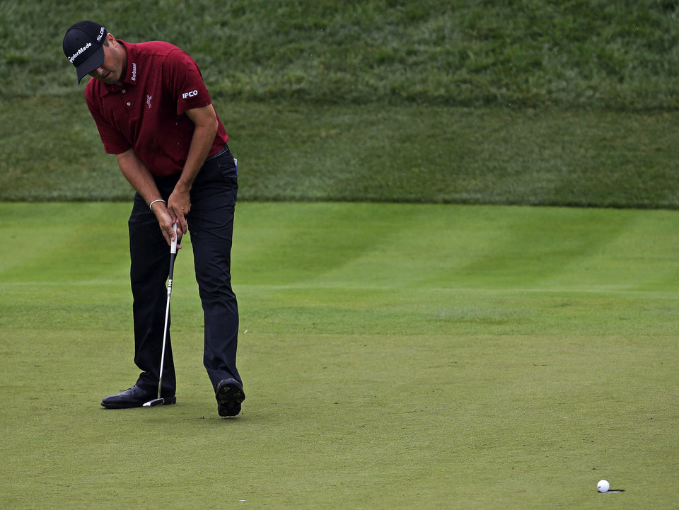 Photo - Ryan Palmer birdies the 17th hole during the second round of the PGA Championship golf tournament at Valhalla Golf Club on Friday, Aug. 8, 2014, in Louisville, Ky. (AP Photo/David J. Phillip)