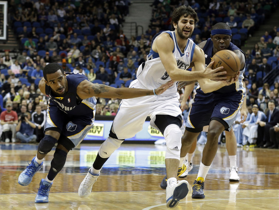 Photo - Memphis Grizzlies' Mike Conley, left, and Zach Randolph, right, try to get at the ball as Minnesota Timberwolves' Ricky Rubio, center, of Spain, drives in the first quarter of an NBA basketball game on Saturday, March 30, 2013, in Minneapolis. (AP Photo/Jim Mone)