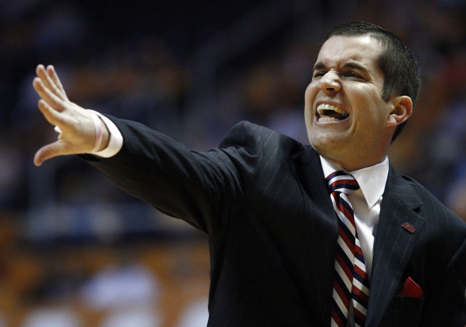 Photo - Mississippi coach Matt Insell yells to his players during the second half of an NCAA college basketball game against Tennessee on Thursday, Jan. 9, 2014, in Knoxville, Tenn. Tennessee won 94-70. (AP Photo/Wade Payne)