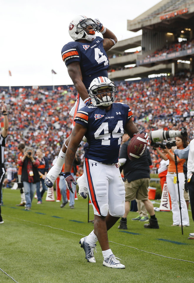Photo - Auburn running back Cameron Artis-Payne (44) celebrates with wide receiver Quan Bray (4) after scoring a touchdown in the first half of the annual A Day spring intrasquad NCAA college football game on Saturday, April 19, 2014, in Auburn, Ala. (AP Photo/John Bazemore)