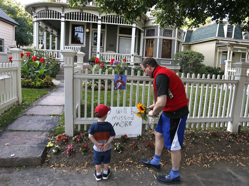 "Photo - U.S. Rep. Jared Polis, D-Colo., and his son AJ leave flowers at the home where the 80's TV series ""Mork & Mindy"", starring the late Robin Williams, was set, in Boulder, Colo., Monday Aug. 11, 2014. Robin Williams, the Academy Award winner and comic supernova whose explosions of pop culture riffs and impressions dazzled audiences for decades and made him a gleamy-eyed laureate for the Information Age, died Monday in an apparent suicide. He was 63. (AP Photo/Brennan Linsley)"
