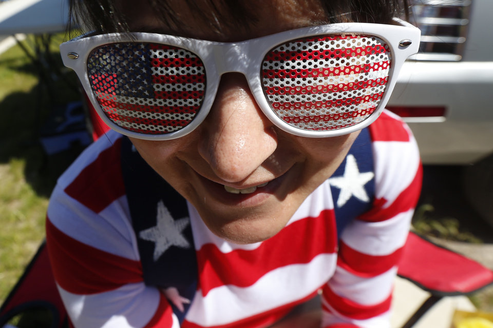 Photo - Michelle Whyte, 34, of Hoboken, N.J., wears the United States colors on her sunglasses and shirt while tailgating before the start of an international soccer friendly between Turkey and the United States, Sunday, June 1, 2014, in Harrison, N.J. (AP Photo/Julio Cortez)