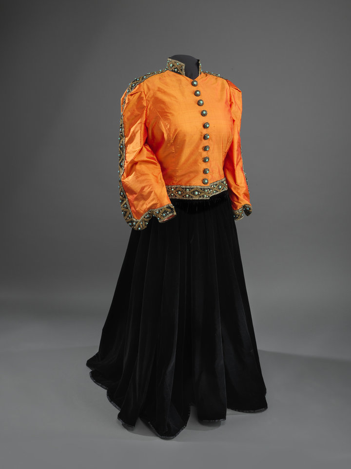 Photo - This undated handout photo provided by the National Museum of American History shows a Shantung silk jacket, redesigned in 1993, and black velvet skirt worn by Marian Anderson during her historic performance on the Lincoln Memorial in Washington in 1939. For the first time, Anderson's orange-and-black blouse and skirt ensemble that she wore during her historic performance on the Lincoln Memorial steps 75 years ago will go on display at the Smithsonian. Anderson was a groundbreaking opera singer but was kept out of Washington's Constitution Hall because she was black, and Eleanor Roosevelt invited her to perform at the Lincoln Memorial instead. The concert attire is part of a collection being donated to the National Museum of African American History and Culture by a member of Anderson's extended family to mark the anniversary of Anderson's concert on Wednesday. It will be displayed beginning Tuesday and will remain on view until September. (AP Photo/Hugh Talman)