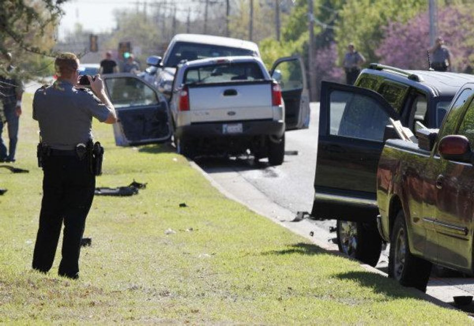 Photo - WRECK: Oklahoma City Police investigate a four-car injury accident at the intersection of NW 122 and Meridian in Oklahoma City, OK, Friday, April 1, 2011. By Paul Hellstern, The Oklahoman ORG XMIT: KOD