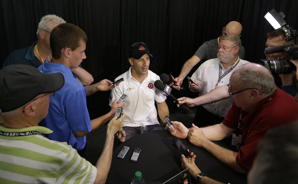 Photo - Tony Kanaan, of Brazil, responds to a question during a media interview for the Indianapolis 500 IndyCar auto race at the Indianapolis Motor Speedway in Indianapolis, Thursday, May 22, 2014. (AP Photo/Darron Cummings)