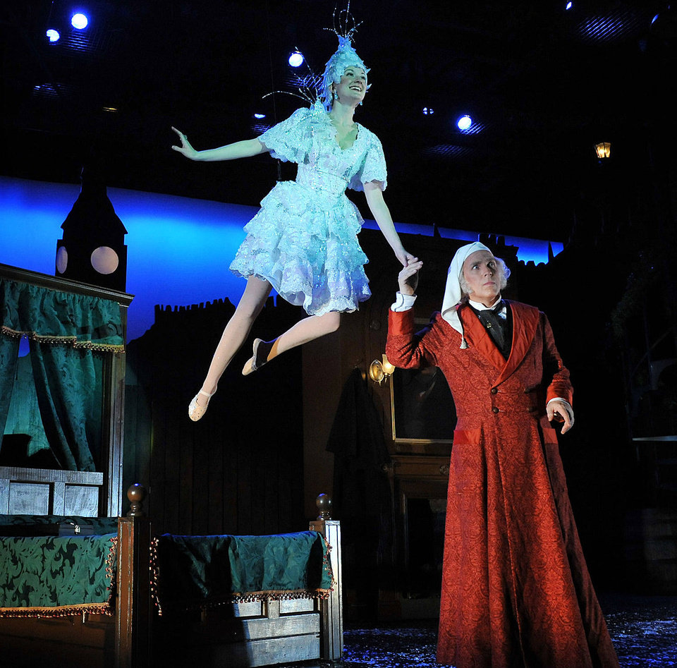 The Ghost of Christmas Past (Jayme Petete) shows Ebenezer Scrooge (Jonathan Beck Reed) scenes from his past in Lyric at the Plaza\'s