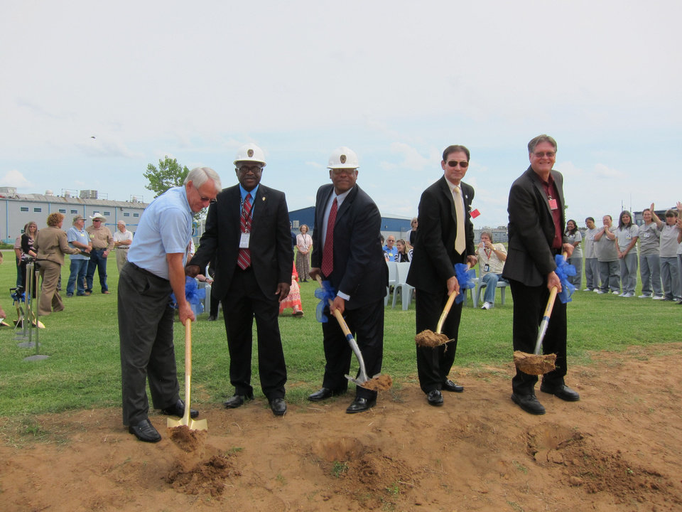 Photo - Dignitaries hoist dirt with ceremonial shovels during a recent groundbreaking for a new chapel to be built in September at Mabel Bassett Correctional Center in McLoud. From left to right are: state Sen. Wayne Shaw, R-Grove; Rickey Moham, Mabel Bassett warden; Edward Evans, state Department of Corrections interim director; state Sen. Ron Sharp, R-Shawnee; and the Rev. Joe Wilson, domestic coordinator for faith-based World Mission Builders.  Carla Hinton - The Oklahoman