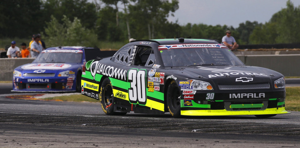 Photo -   Nelson Piquet Jr (30) leads Ron Fellows, left, through a turn during the NASCAR Nationwide Series Sargento 200 auto race at Road America in Elkhart Lake, Wis, Saturday, June, 23, 2012. Piquet Jr. went on to win the race. (AP Photo/Jeffrey Phelps)