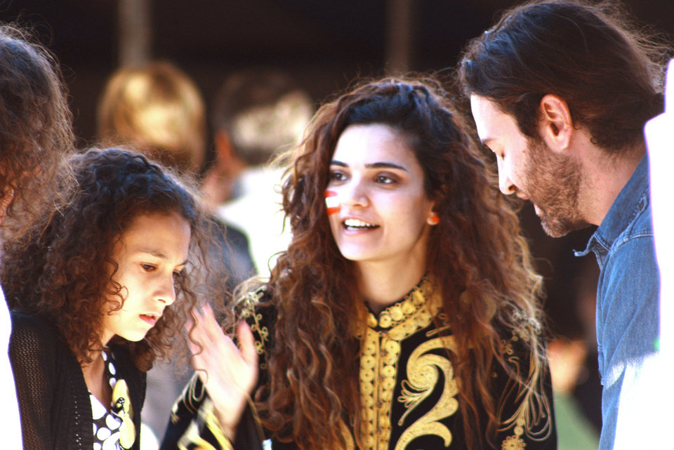 Photo - Daisy Toubia, center, and her husband Nagib Toubia answer questions for festival attendees at the