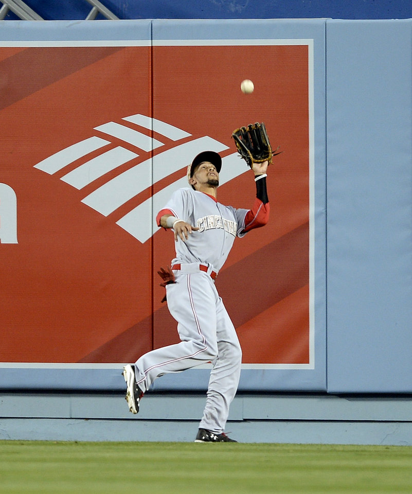 Photo - Cincinnati Reds center fielder Billy Hamilton catches a fly from Los Angeles Dodgers Justin Turner in the eighth inning of a baseball game, Monday, May 26, 2014, in Los Angeles. The Dodgers won 4-3. (AP Photo/Gus Ruelas)