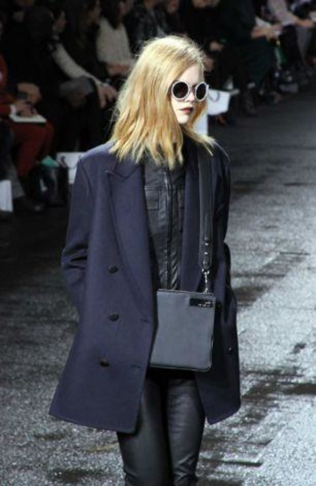 Photo -  Phillip Lim's fall 2013 collection is modeled on the runway in New York. AP