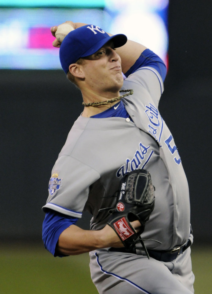 Photo -   Kansas City Royals pitcher Will Smith throws against the Minnesota Twins in the first inning of a baseball game, Tuesday, Sept. 11, 2012, in Minneapolis. (AP Photo/Jim Mone)