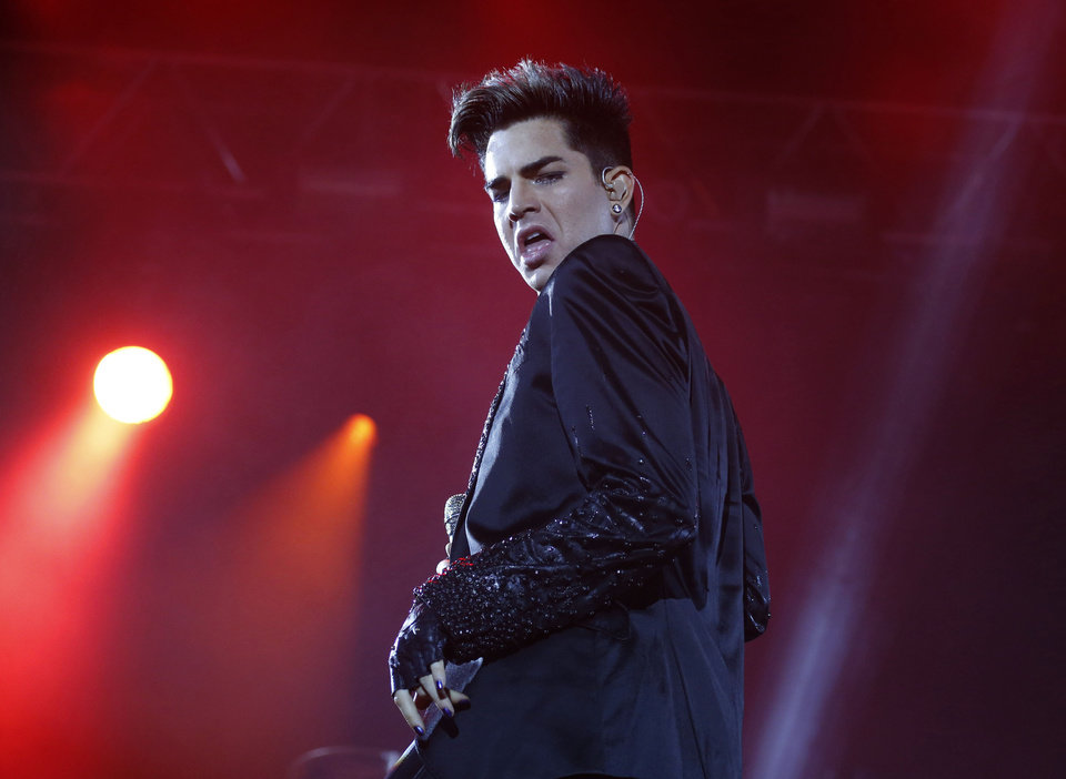 Photo -   In this June 30, 2012 file photo, Adam Lambert and the rock group Queen perform in a fan zone during the Euro 2012 soccer championship tournament in Kiev, Ukraine. Lambert is among the various names being tossed around as an