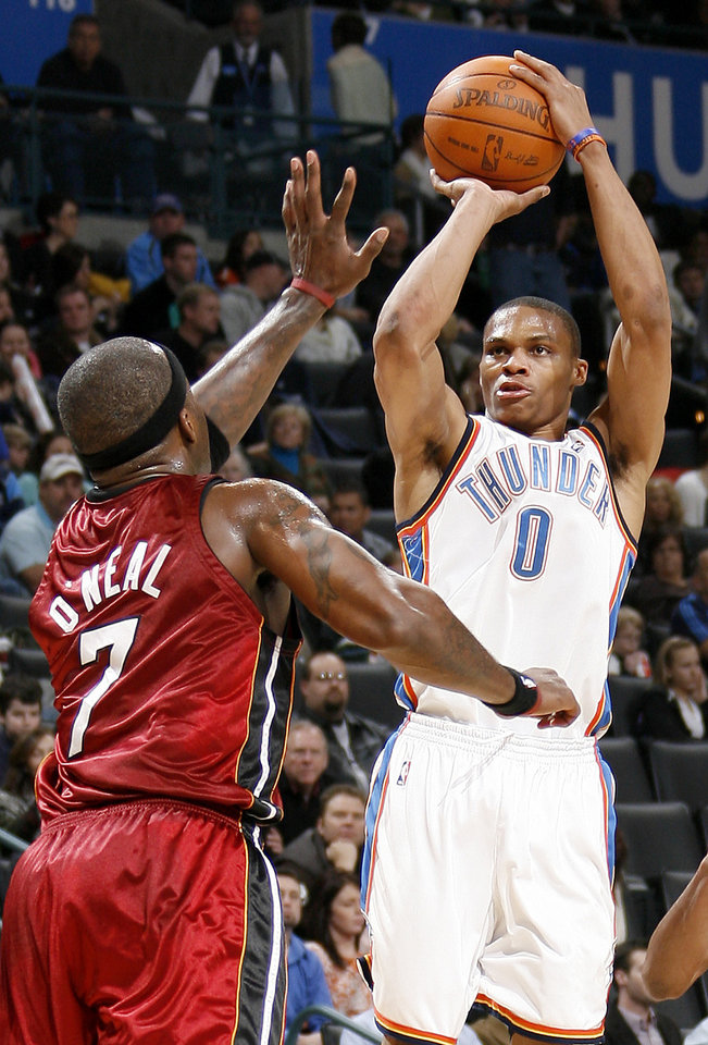 Photo - Oklahoma City's Russell Westbrook shoots the ball in front of Miami's Jermaine O'Neal during the NBA basketball game between the Oklahoma City Thunder and the Miami Heat at the Ford Center in Oklahoma City, Saturday, January 16, 2010. Photo by Bryan Terry, The Oklahoman