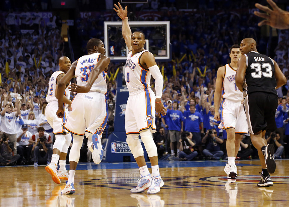 Oklahoma City's Russell Westbrook (0) celebrates a basket during Game 4 of the Western Conference Finals in the NBA playoffs between the Oklahoma City Thunder and the San Antonio Spurs at Chesapeake Energy Arena in Oklahoma City, Tuesday, May 27, 2014. Photo by Nate Billings, The Oklahoman