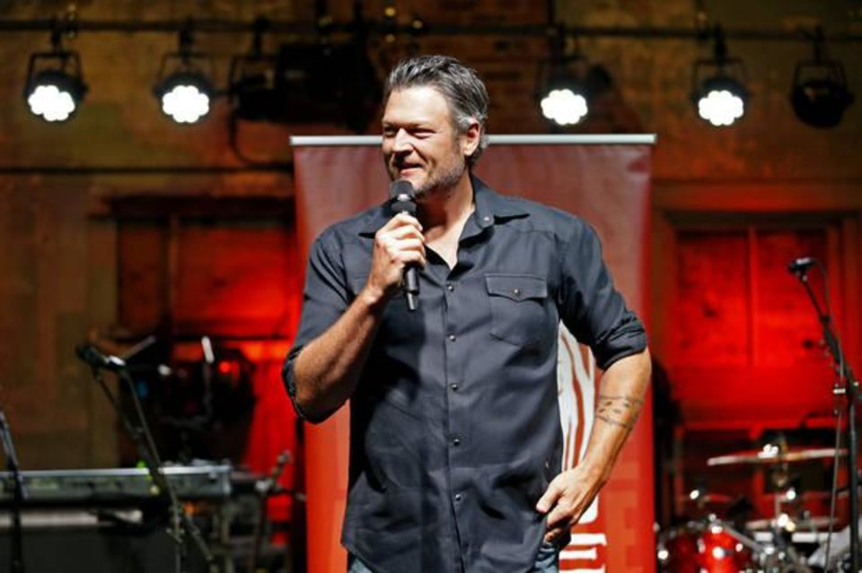 Photo - Entertainer Blake Shelton fields questions standing on the stage of his Ole Red restaurant/bar on Friday, Sept. 29, 2017 in Tishomingo, Okla. [The Oklahoman Archives photo]