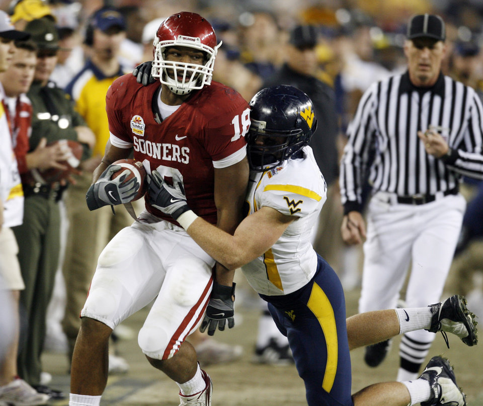 Photo - Tight end Germaine Gresham is pushed out of bounds after a catch during the second half of the Fiesta Bowl college football game between the University of Oklahoma Sooners (OU) and the West Virginia University Mountaineers (WVU) at The University of Phoenix Stadium on Wednesday, Jan. 2, 2008, in Glendale, Ariz. 