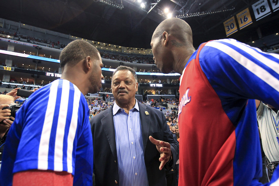 Photo - The Rev. Jesse Jackson, center, talks to Los Angeles Clippers' Chris Paul and Jamal Crawford before Game 5 of the Clippers' opening-round NBA basketball playoff series against the Golden State Warriors on Tuesday, April 29, 2014, in Los Angeles. NBA Commissioner Adam Silver announced Tuesday that Clippers owner Donald Sterling has been banned for life by the league. (AP Photo/Ringo H.W. Chiu)