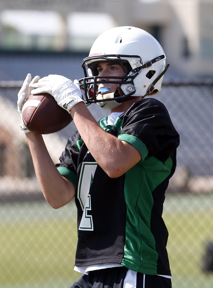 Photo - Nick Kerrihard catches a pass during football practice at Bishop McGuinness High School in Oklahoma City, Okla.,  Tuesday, Aug. 12, 2014. Photo by Sarah Phipps, The Oklahoman