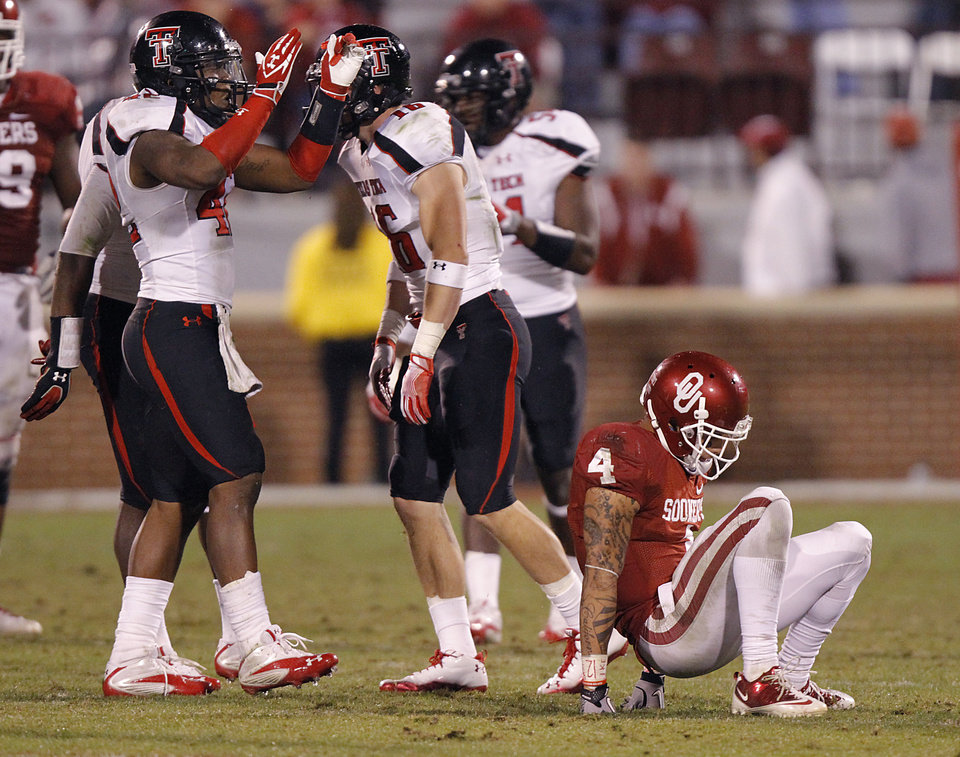 Oklahoma's Kenny Stills (4) picks himself off the field as Texas Tech's Daniel Cobb (42) reacts after breaking up a pass during the college football game between the University of Oklahoma Sooners (OU) and Texas Tech University Red Raiders (TTU) at the Gaylord Family-Oklahoma Memorial Stadium on Sunday, Oct. 23, 2011. in Norman, Okla. Photo by Chris Landsberger, The Oklahoman