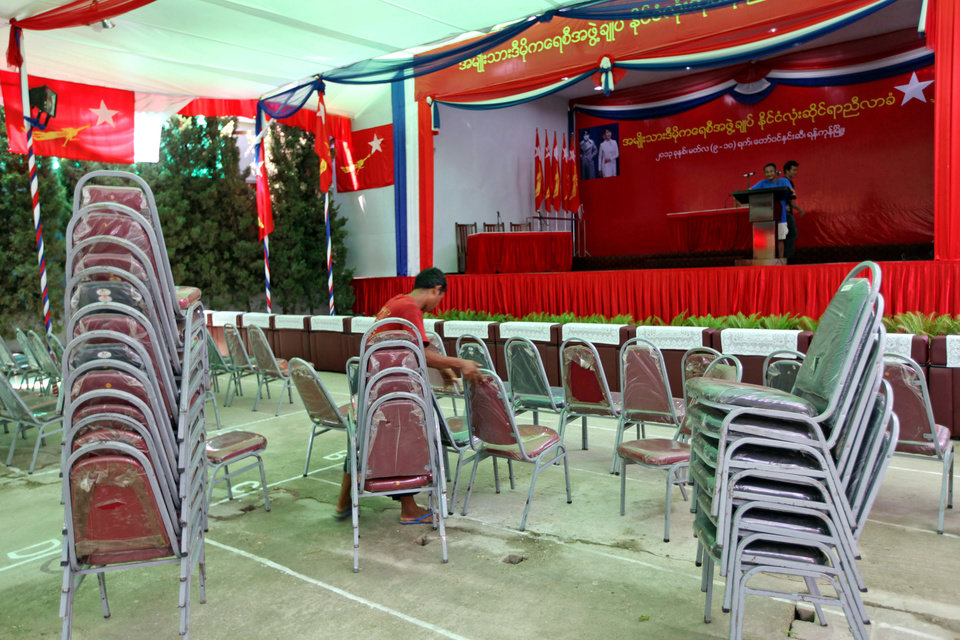 Photo - A member of the National League for Democracy (NLD) arranges chairs as he prepares for the party congress at Royal Rose restaurant Thursday, March 7, 2013 in Yangon, Myanmar. In another sign of political reform and reconciliation in Myanmar, the country's biggest party led by opposition leader Aung San Suu Kyi will hold its first-ever congress in the country's former capital from Friday. (AP Photo/Khin Maung Win)