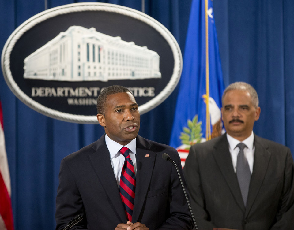 Photo - Tony West, theJustice Department's lead negotiator, left, and Attorney General Eric Holder, announce at the Justice Department in Washington Monday, July 14, 2014, that Citigroup will pay $7 billion to settle an investigation into risky subprime mortgages, the type that helped fuel the financial crisis. The agreement comes weeks after talks between the sides broke down, prompting the government to warn that it would sue the New York investment bank. The bank had offered to pay less then $4 billion, a sum substantially less that what the Justice Department was asking for. The settlement stems from the sale of securities made up of subprime mortgages, which fueled both the housing boon and bust that triggered the Great Recession at the end of 2007. (AP Photo/Pablo Martinez Monsivais)