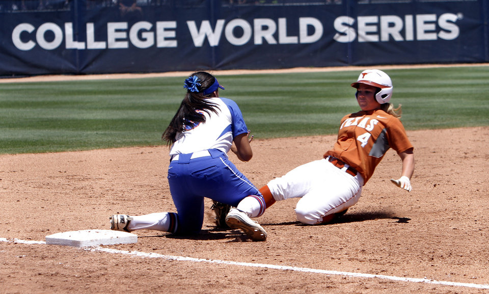 Photo - Florida third baseman Stephanie Tofft tags out Texas runner Torie Schmidt in the Women's College World Series elimination game versus Texas. The Longhorns would go on to win 3-0. Photo by KT KING, The Oklahoman