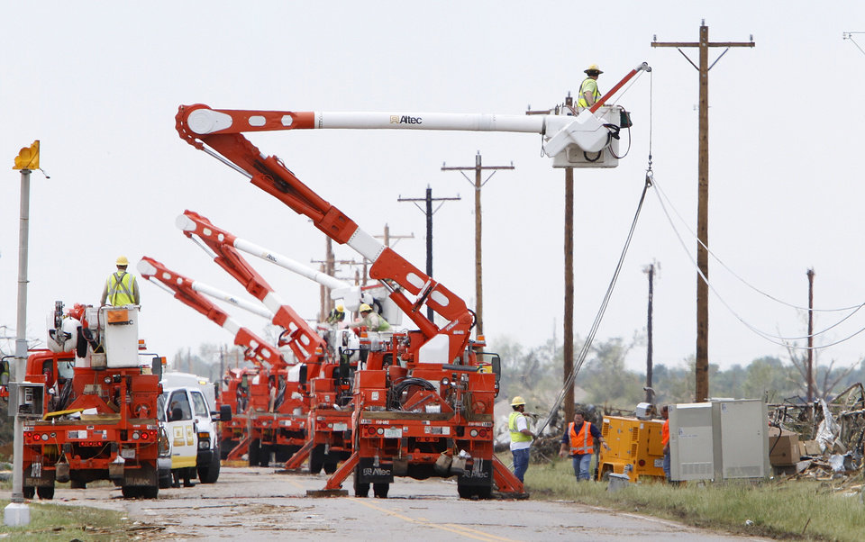 OG&E crews works to restore power on SW 149th in Oklahoma City , Thursday May 23, 2013. The area was hit by a massive tornado on Monday.Photo By Steve Gooch, The Oklahoman