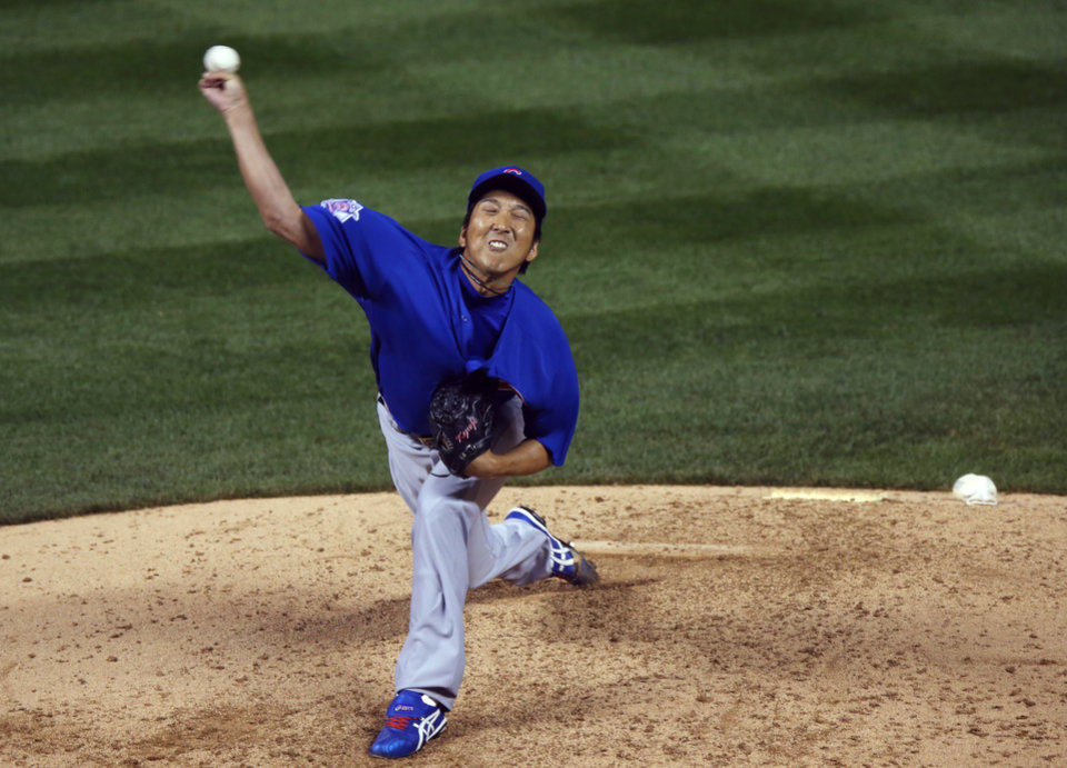 Photo - Making his first appearance since Tommy John surgery in June 2013, Chicago Cubs relief pitcher Kyuji Fujikawa works against the Colorado Rockies in the sixth inning of a baseball game in Denver on Wednesday, Aug. 6, 2014. (AP Photo/David Zalubowski)