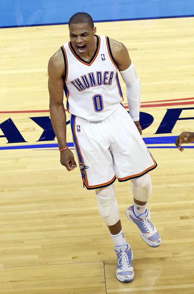 Photo - Oklahoma City's Russell Westbrook (0) celebrates during Game 2 of the Western Conference semifinals in the NBA playoffs between the Oklahoma City Thunder and the Los Angeles Clippers at Chesapeake Energy Arena in Oklahoma City, Wednesday, May 7, 2014. Photo by Sarah Phipps, The Oklahoman