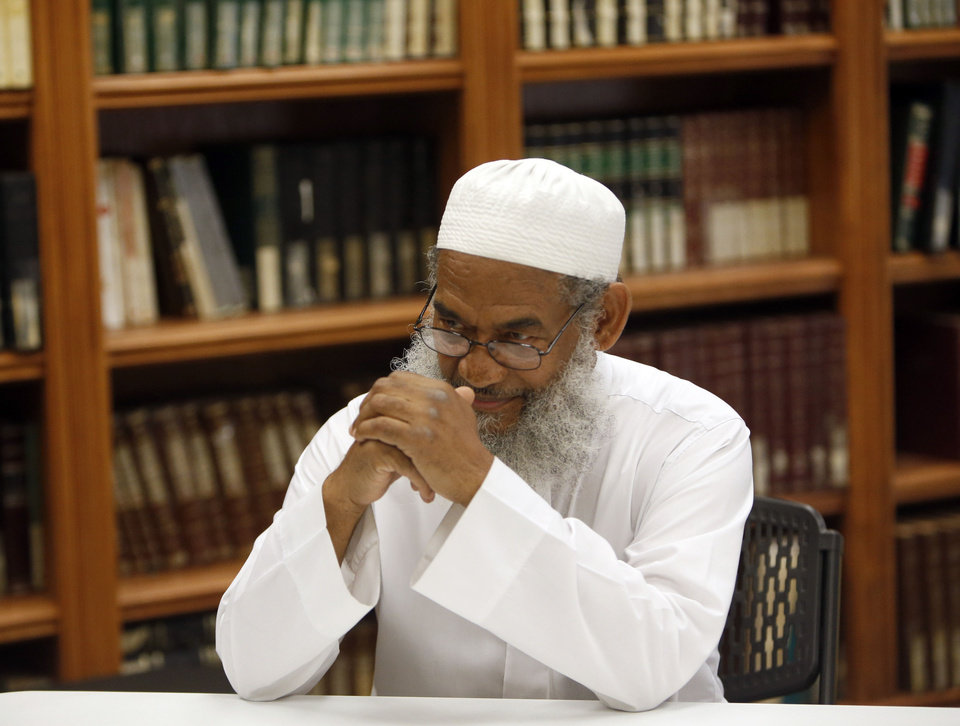 Photo - Abdur Rahman sits in the library at the Islamic Society of Norman's new mosque at 420 E Lindsey in Norman. Rahman is the society's president and acting imam.    SARAH PHIPPS - SARAH PHIPPS