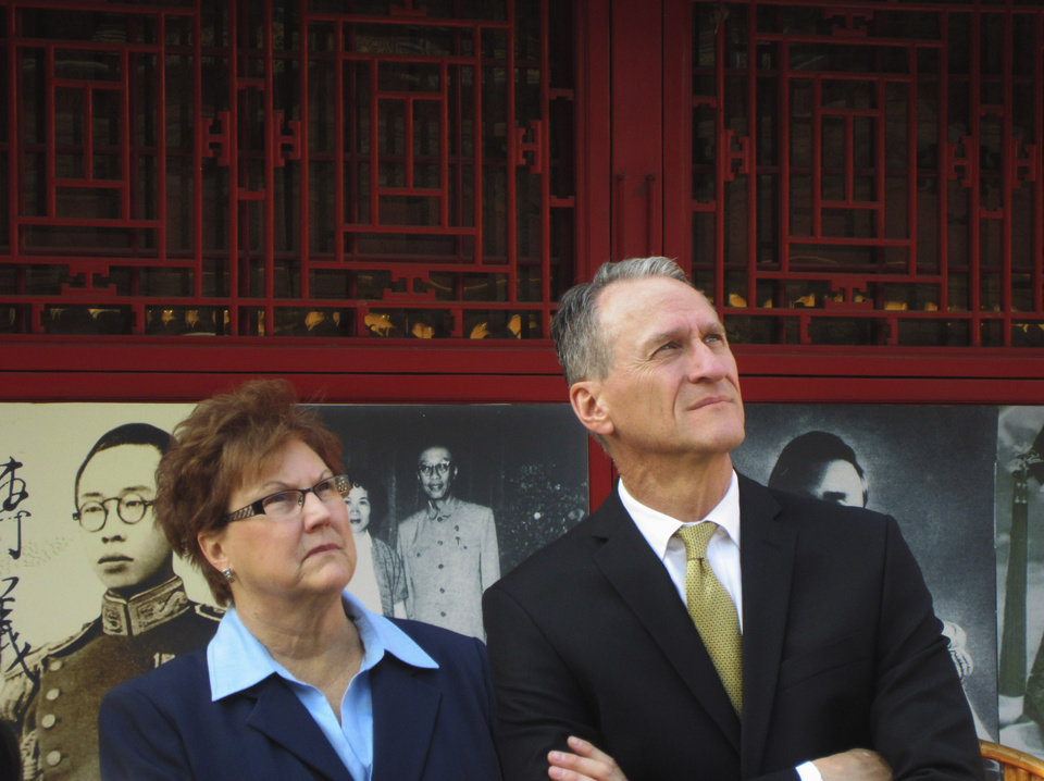 Photo - This March 2012 photo provided by Gov. Dennis Daugaard's office shows South Dakota Gov. Dennis Daugaard and his wife, Linda, in China during his first trade mission to the world's most populous nation. Daugaard will be joined by representatives from 11 companies and groups from around South Dakota when he makes his third trade mission to China May 9-16, 2014. (AP Photo/Courtesy of Gov. Dennis Daugaard's Office)