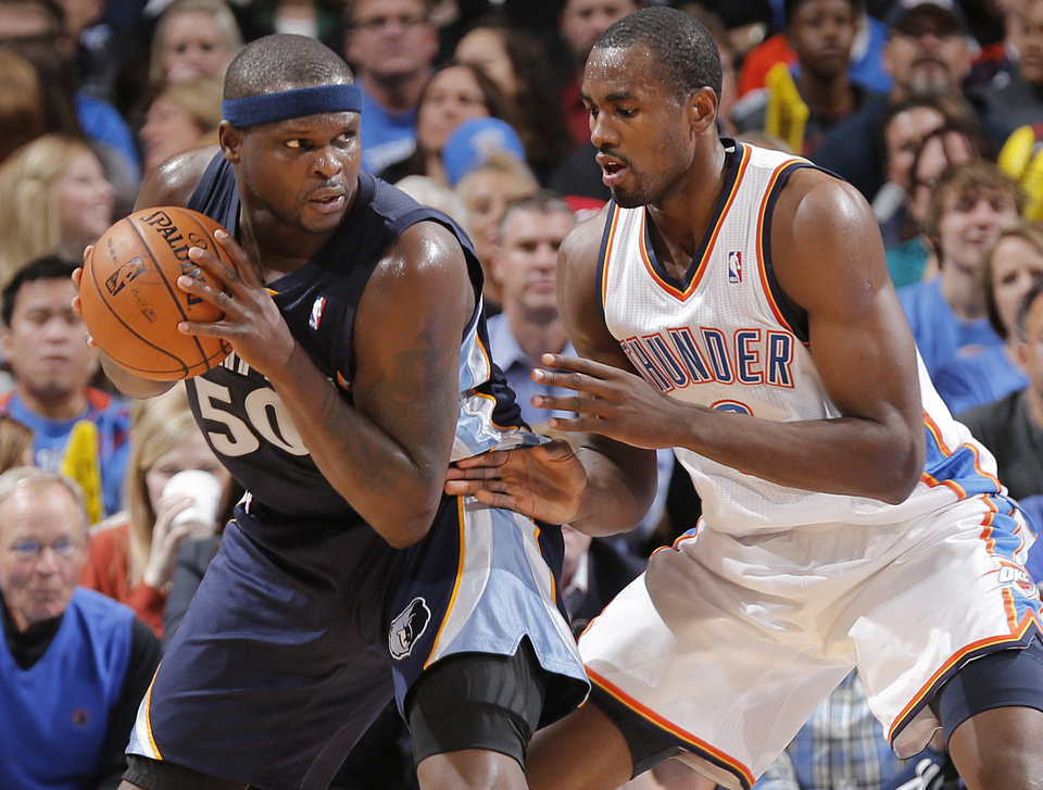 Oklahoma City\'s Serge Ibaka (9) defends on Memphis\' Zach Randolph (50) during the NBA basketball game between the Oklahoma City Thunder and the Memphis Grizzlies at Chesapeake Energy Arena on Wednesday, Nov. 14, 2012, in Oklahoma City, Okla. Photo by Chris Landsberger, The Oklahoman