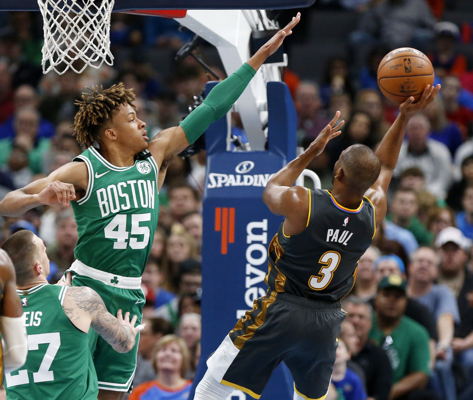 Photo - Oklahoma City's Chris Paul (3) shoots as Boston's Romeo Langford (45) defends in the second quarter during an NBA basketball game between the Oklahoma City Thunder and the Boston Celtics at Chesapeake Energy Arena in Oklahoma City, Sunday, Feb. 9, 2020. [Nate Billings/The Oklahoman]