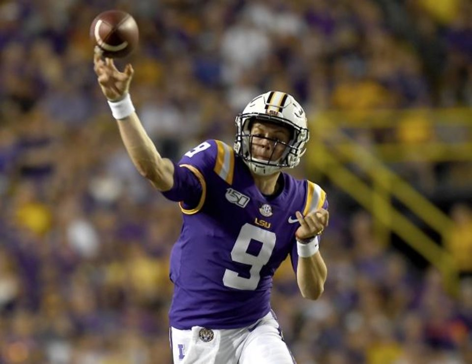 Photo -  LSU quarterback Joe Burrow is a candidate to win the Heisman Trophy. The Ohio State transfer had led LSU to an undefeated regular season and a spot in the Dec. 28 Peach Bowl against Oklahoma. [AP Photo/Patrick Dennis]