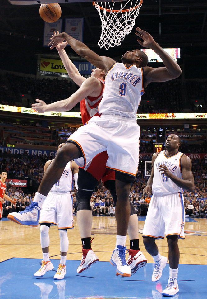 Oklahoma City 's Serge Ibaka (9) blocks a shot by Houston's Omer Asik (3) during the NBA basketball game between the Houston Rockets and the Oklahoma City Thunder at the Chesapeake Energy Arena on Wednesday, Nov. 28, 2012, in Oklahoma City, Okla.   Photo by Chris Landsberger, The Oklahoman