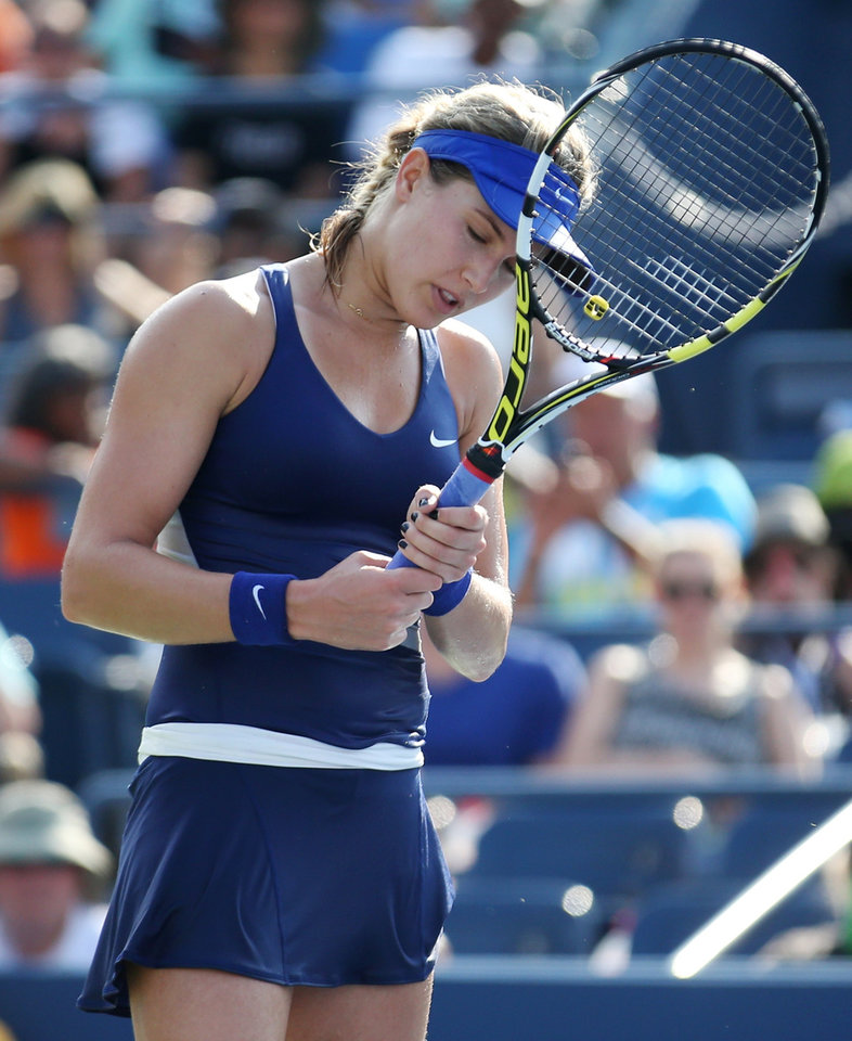 Photo - Eugenie Bouchard, of Canada, reacts after a shot against Ekaterina Makarova, of Russia, during the fourth round of the 2014 U.S. Open tennis tournament, Monday, Sept. 1, 2014, in New York. (AP Photo/John Minchillo)