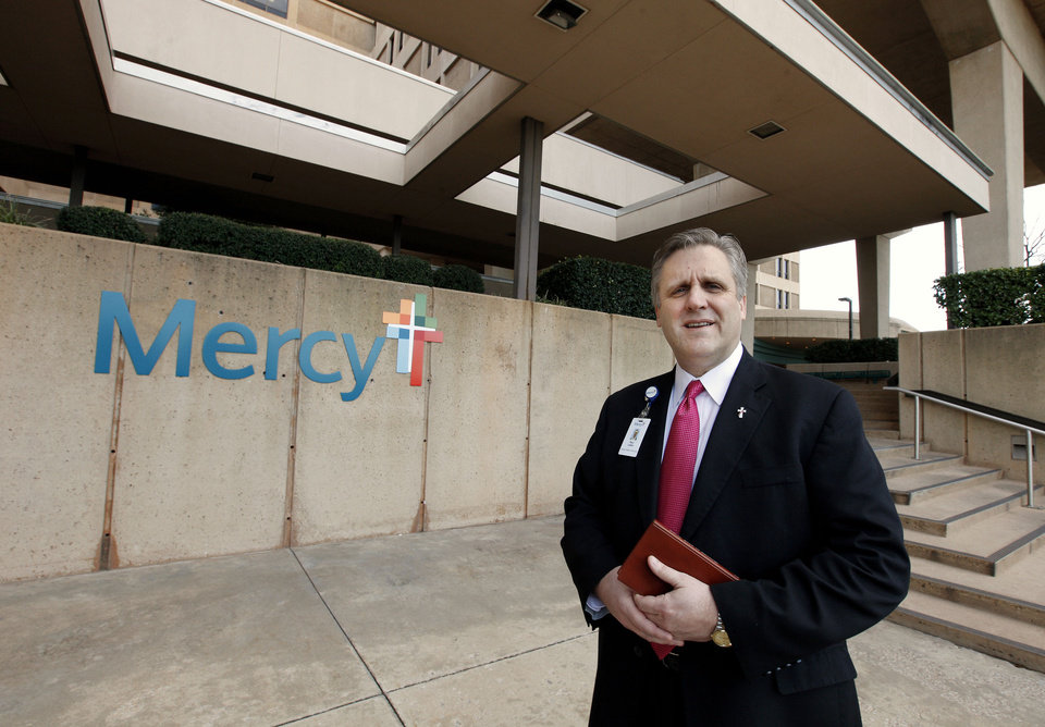 Photo - Deacon Paul Lewis, director of pastoral services at Mercy Hospital, at the entrance to Mercy Hospital in Oklahoma City Monday, Feb. 11, 2013. Photo by Paul B. Southerland, The Oklahoman  PAUL B. SOUTHERLAND - PAUL B. SOUTHERLAND