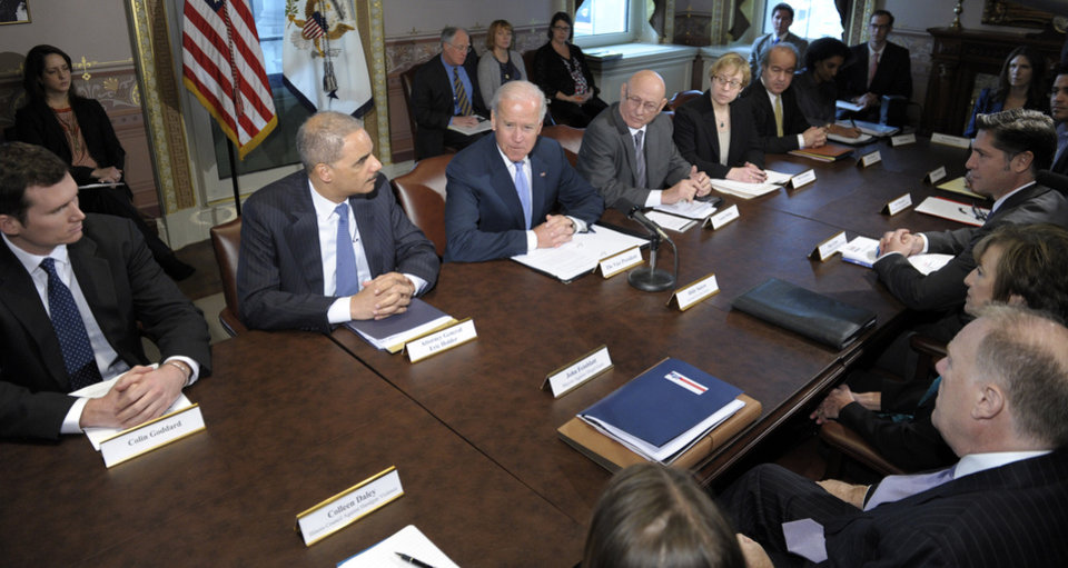Photo - Vice President Joe Biden, center, with Attorney General Eric Holder at left, speaks during a meeting with victims' groups and gun safety organizations in the Eisenhower Executive Office Building on the White House complex in Washington, Wednesday, Jan. 9, 2013. Biden is holding a series of meetings this week as part of the effort he is leading to develop policy proposals in response to the Newtown, Conn., school shooting (AP Photo/Susan Walsh)