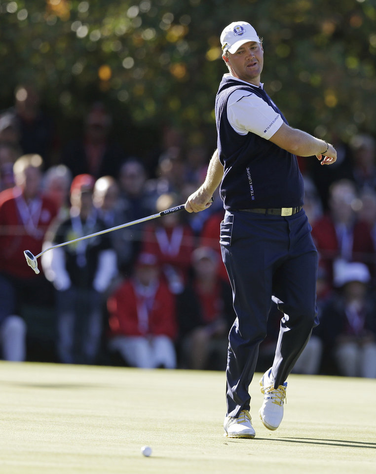 Europe\'s Peter Hanson reacts after missing a birdie putt on the 15th hole during a singles match at the Ryder Cup PGA golf tournament Sunday, Sept. 30, 2012, at the Medinah Country Club in Medinah, Ill. (AP Photo/Chris Carlson) ORG XMIT: PGA173
