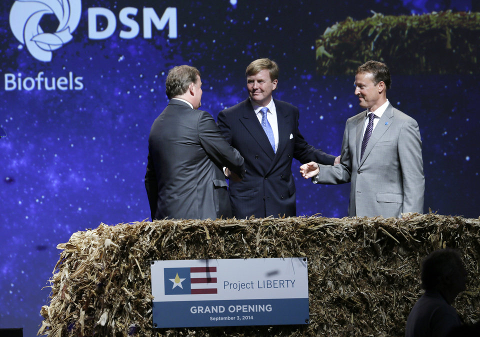 Photo - King Willem-Alexander, center, of the Netherlands greets DSM CEO and Chairman Feike Sijbesma, left, and POET Executive Chairman Jeff Broin during the opening of one of the nation's first commercial size cellulosic ethanol plants, Wednesday, Sept. 3, 2014, in Emmetsburg, Iowa. Project Liberty is a $250 million plant that will make 25 million gallons of ethanol a year from corn cobs, stalks, leaves and other plant residue. (AP Photo/Charlie Neibergall)