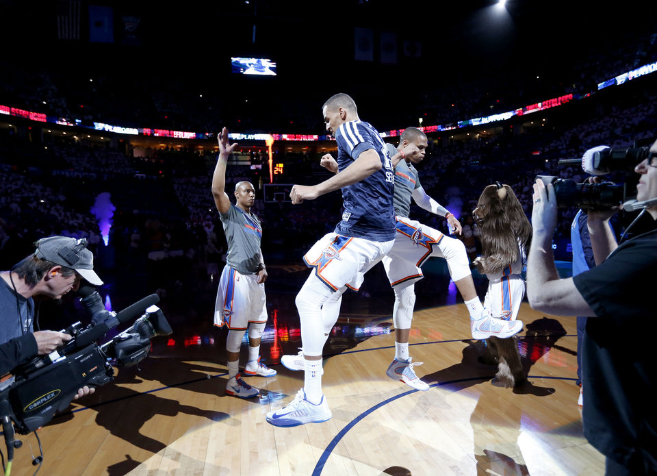 Photo - Oklahoma City's Caron Butler, left, Thabo Sefolosha, and Russell Westbrook during introductions before Game 2 in the first round of the NBA playoffs between the Oklahoma City Thunder and the Memphis Grizzlies at Chesapeake Energy Arena in Oklahoma City, Monday, April 21, 2014. Photo by Nate Billings, The Oklahoman