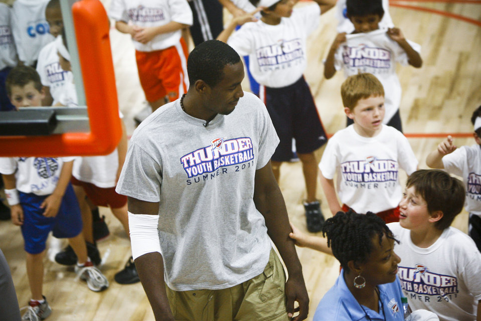 Serge Ibaka talks with 8-year-old Dylan Townsend of Edmond at the Thunder Youth Basketball Camp at the Santa Fe Family Life Center on Tuesday, June 14, 2011. Photo by Zach Gray, The Oklahoman