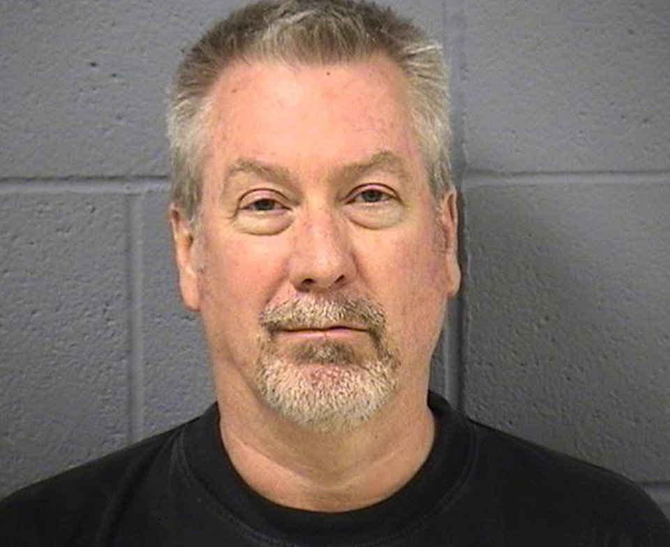 Photo - In this booking photo provided Thursday, May 7, 2009 by the Will County Sheriff's office in Joliet, Ill., former Bolingbrook, Ill., police sergeant Drew Peterson is shown. Peterson was indicted Thursday charged with two counts of first-degree murder in the drowning death of his former wife Kathleen Savio who found dead in an empty bathtub in 2004. (AP Photo/Will County Sheriff's Office) ORG XMIT: ILRG101