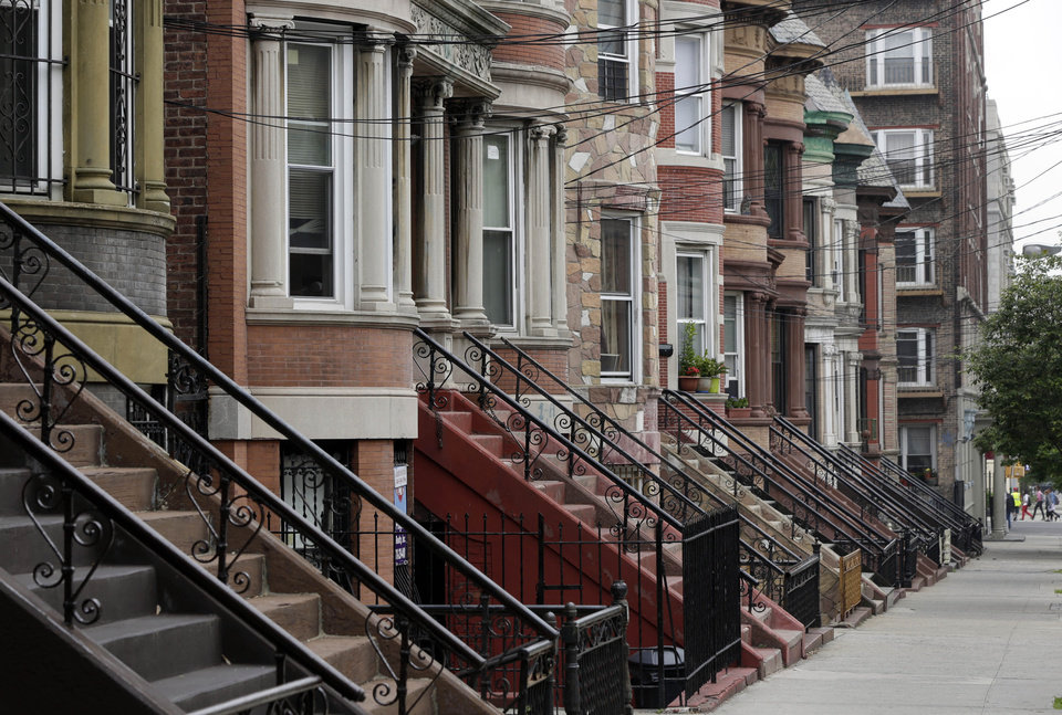 Photo - Manicured homes line a street in the Longwood Historic District, in The Bronx borough of New York,  Wednesday, May 22, 2013.  A company that offered tourist treks to the Bronx