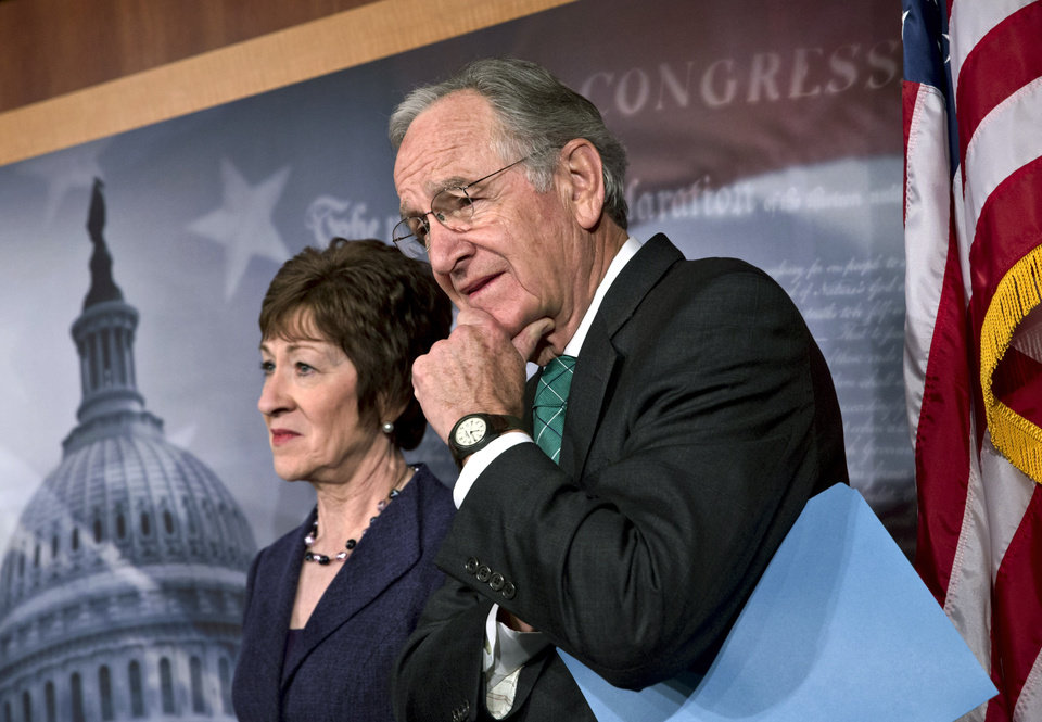 Photo - Sen. Tom Harkin, D-Iowa, right, chairman of the Health, Education, Labor, and Pensions Committee, stands with Sen. Susan Collins, R-Maine, just after the Senate cleared a major hurdle and agreed to proceed to debate a bill that would prohibit workplace discrimination against gay, bisexual and transgender Americans, at the Capitol in Washington, Monday, Nov. 4, 2013. The bipartisan vote increases the chances that the Senate will pass the bill by week's end, but its prospects in the Republican-led House are dimmer. (AP Photo/J. Scott Applewhite)