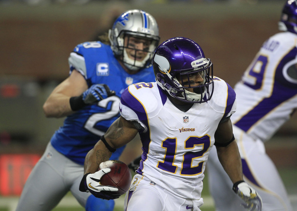 Minnesota Vikings' Percy Harvin (12) returns the opening kick for a touchdown during the first quarter of an NFL football game against the Detroit Lions at Ford Field in Detroit, Sunday, Sept. 30, 2012. (AP Photo/Carlos Osorio)