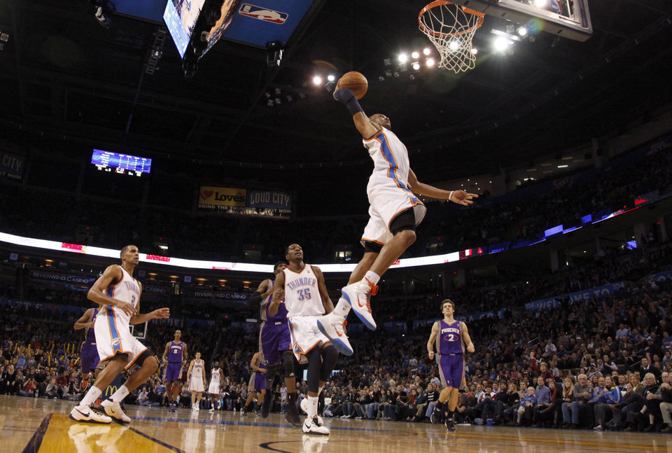 Photo - Oklahoma City's Russell Westbrook (0) goes up for a dunk during the NBA basketball game between the Oklahoma City Thunder and the Phoenix Suns, Sunday, Dec. 19, 2010, at the Oklahoma City Arena. Photo by Sarah Phipps, The Oklahoman
