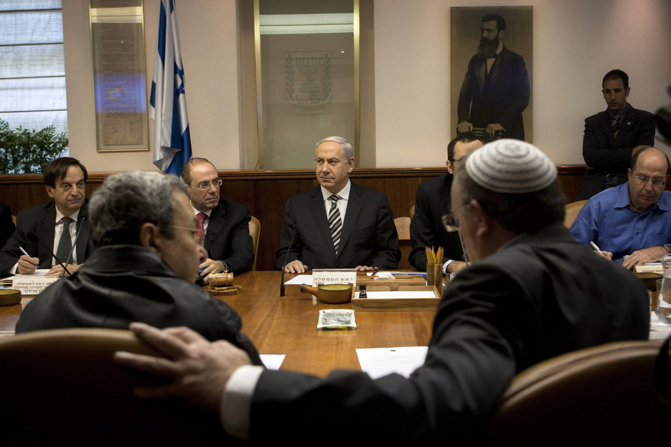 Photo -   Israeli Prime Minister Benjamin Netanyahu, center, together with Vice Prime Minister Silvan Shalom, second left, Deputy Prime Minister Dan Meridor, left, Cabinet Minister Moshe Yaalon, right, Israeli Defense Minister Ehud Barak, front row left, and Minister of Science and Technology Daniel Hershkowitz, attend the weekly cabinet Jerusalem, Sunday, Nov. 11, 2012. Netanyahu says his country is ready to strike harder against Gaza Strip militants if they don't stop attacking Israel. (AP Photo/Sebastian Scheiner, Pool)